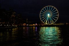Seattle Washington City Skyline & Ferris Wheel on Wharf late at night stock photo
