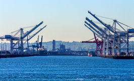 Seattle Washington Port with Red White Cranes and Freighters Royalty Free Stock Images