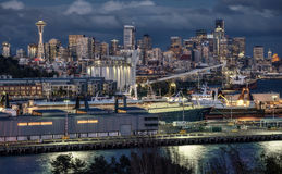 Seattle, Washington Skyline and Port at Dusk. Night Falls on the City of Seattle and its Harbor Stock Photography