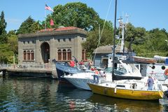 Pleasure boats at locks. SEATTLE, WASHINGTON, USA JULY 7, 2017: Boat owners working to tie boats together in preparation to be lowered in the Hiram M Chittenden Stock Photos