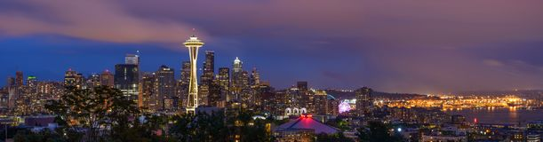 Seattle at Night. Seattle, Washington, USA - May 28, 2016: A panoramic view of a cloudy spring night at Seattle Downtown and its busy harbor Royalty Free Stock Photo