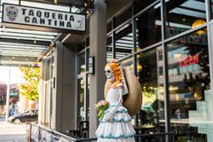 A sculpture of a skeleton bride at the entrance of the Taqueria Cantina in Seattle stock photography