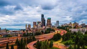 Seattle, Washington, USA. Downtown skyline and highways at dusk stock footage