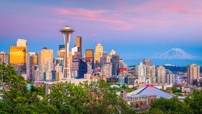 Seattle, Washington, USA Skyline. Seattle, Washington, USA downtown skyline at night with Mt. Rainier stock images