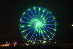 Seattle Wheel Blue Friday Pre Superbowl. Seattle's Great Wheel in Seahawks Colors on Blue Friday royalty free stock photography
