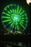 Seattle Wheel Blue Friday Pre Superbowl. Seattle's Great Wheel in Seahawks Colors with a football on Blue Friday stock photo