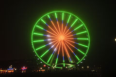 Seattle Wheel Blue Friday Pre Superbowl. Seattle's Great Wheel in Seahawks Colors with a football on Blue Friday stock photography