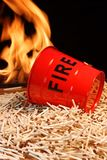 Seau, matchs et flammes de feu Photographie stock