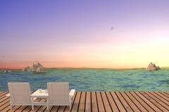 Seaview di tramonto con il salotto della spiaggia delle coppie nella rappresentazione 3D Fotografia Stock