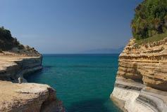 Seaview mit Sandsteinklippen Stockfotografie