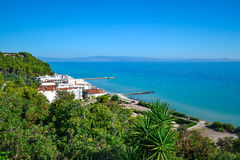 Seaview. Mountains covered with green plants and pensions. Greece. Kassandra. Halkidiki Stock Image
