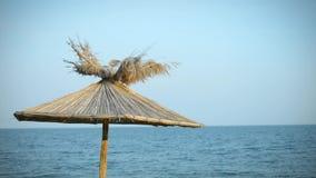 Seaview panorama with blue sky and sunshade stock video footage