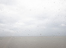 Seaview through the raindrops on window Stock Photography
