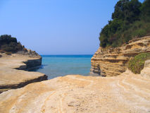 Seaview. Sandstone cliffs and bushes. At the seashore - Canal D'Amour in the island of Corfu, Greece Royalty Free Stock Photos