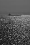Seaview with silhouette of ferry boat in bw II Stock Images