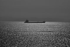 Seaview with silhouette of ferry boat in bw Stock Photo