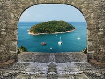 Seaview through the stone arch. View of the tropical island through the stone arch Royalty Free Stock Photo