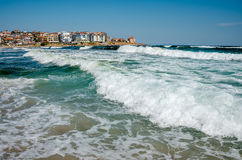 Seaview with waves. And old town on background Stock Photo