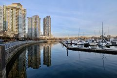 Seawall and boats in city marina. Royalty Free Stock Photo