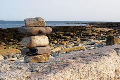 Seawall cairn Stock Images