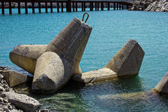 Seawall coastline barricade. Seawall coastline barrier construction, concrete tripods Royalty Free Stock Image