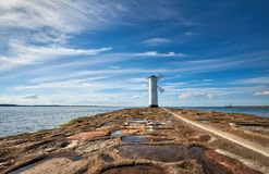 Seawall and historic lighthouse in Swinoujscie, Poland. Seawall and historic lighthouse in Swinoujscie, a port in Poland on the Baltic Sea Stock Image