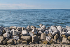 Seawall in the Netherlands made from big basalt ro Stock Photos