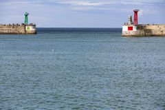 Seawall with red and green lighthouses Stock Photos