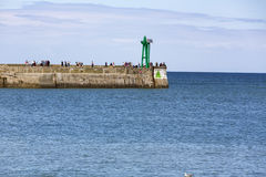 Seawall with red and green lighthouses Royalty Free Stock Images