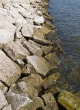 Seawall Rocks. Rip rap, or rocks laid in to protect the Chesapeake Bay shoreline, in place in Chesapeake Beach, Maryland USA stock image