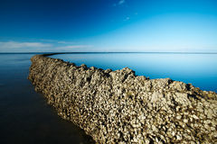 Seawall under deep blue sky Royalty Free Stock Photography