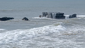 Seawater flows with stones. Uluwatu rocks. Stock Photography