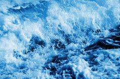 Seawater splashing. Splash of seawater with sea foam and waves royalty free stock photo