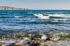 Seawater and stones on the shore Stock Photography