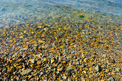 Seawater and stones on the shore Royalty Free Stock Image