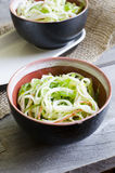 Seaweed and crab sticks  salad. In a bowl on wooden background Stock Images