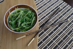 Seaweed for dinner. Seaweed in an asian bowl with chop sticks on the side Royalty Free Stock Photography