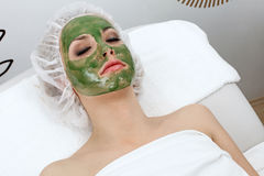 Seaweed mask. Application seaweed mask in professional studio Stock Photos