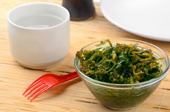 Seaweed salad. Still life with seaweed salad and cup of water Royalty Free Stock Photo