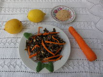 Seaweed salad with carrot lime juice and sesame. Cooking vegetarian healthy food royalty free stock image