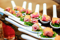Seaweed salad with meat. In the spoon Stock Photography