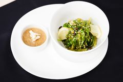 Seaweed salad with a sauce Royalty Free Stock Image
