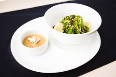 Seaweed salad with a sauce Stock Photography