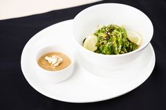 Seaweed salad with a sauce Royalty Free Stock Photos