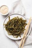 Seaweed salad with sesame seeds. Healthy seaweed salad with sesame seeds royalty free stock image