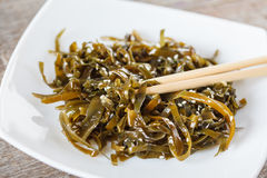 Seaweed salad with sesame seeds and oil.