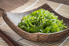 Seaweed salad on wooden plate, Japanese cuisine Stock Image