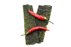 Seaweed sheets and chilli isolated. On a white background Royalty Free Stock Photos