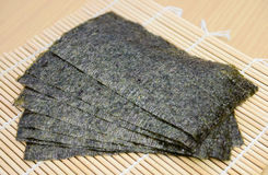 Seaweed snack on bamboo mat Royalty Free Stock Images