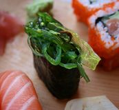 Seaweed sushi. Sushi with bright-green seaweed and sesame seads Royalty Free Stock Photography